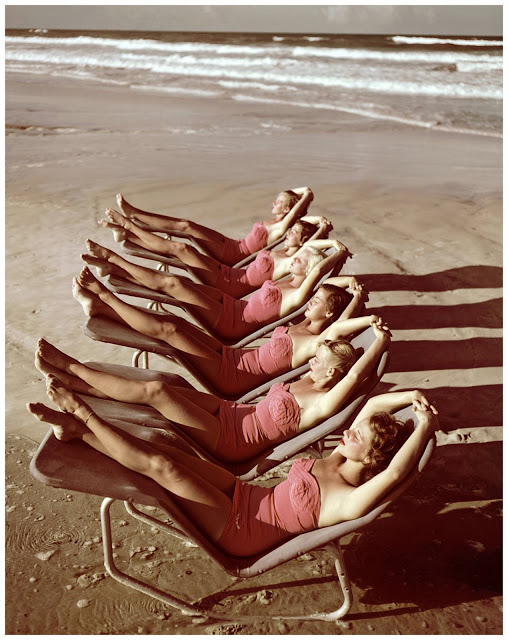 A group of southern belle models sunbathe on the beach at Cypress Gardens theme park in 1953 near Winterhaven, Florida. Getty Archive